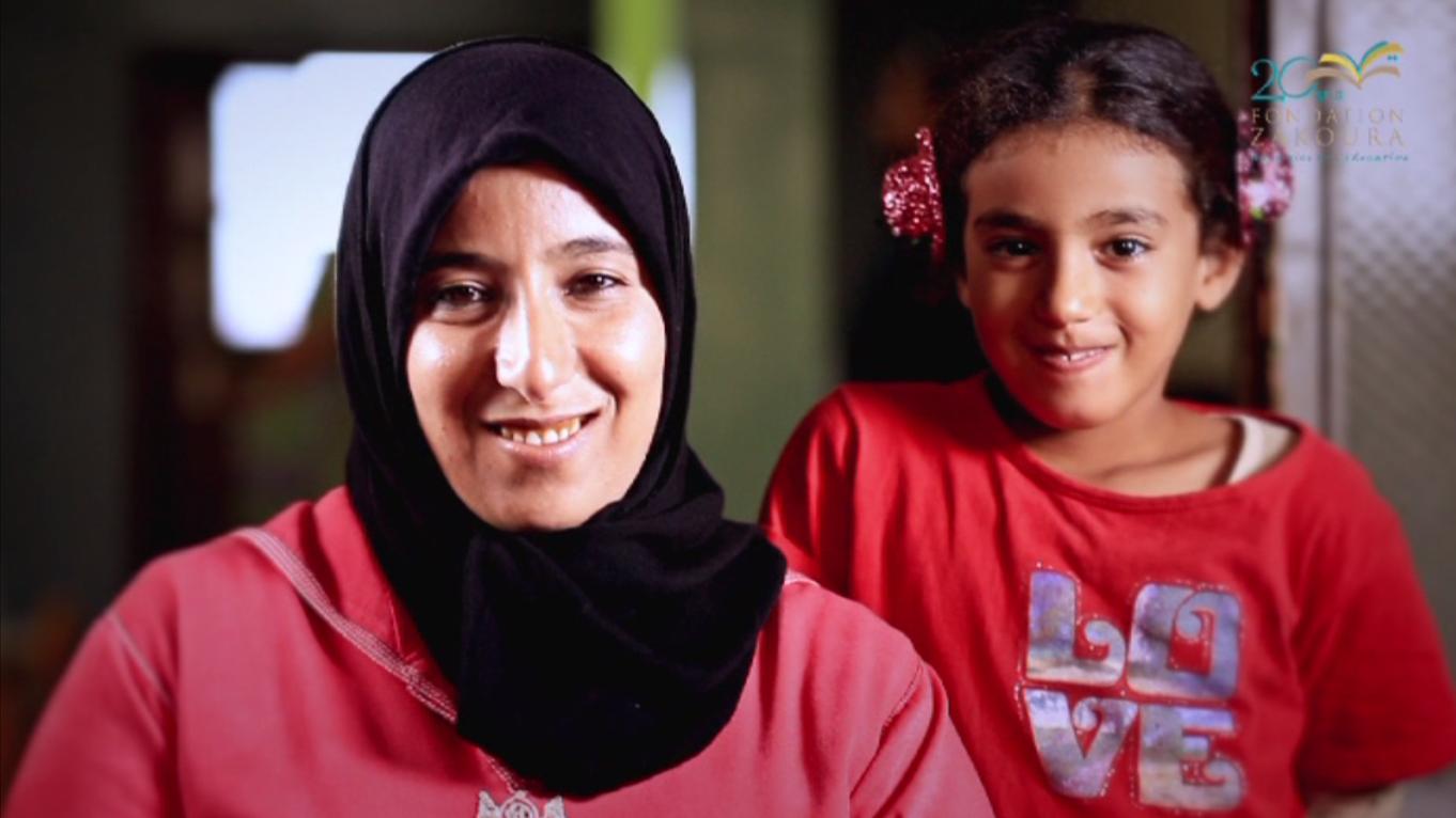 Aicha Karoumi,Bénéficiaire du programme d'alphabétisation et maman de filles bénéficiaires de remédiation scolaire et de préscolaire
